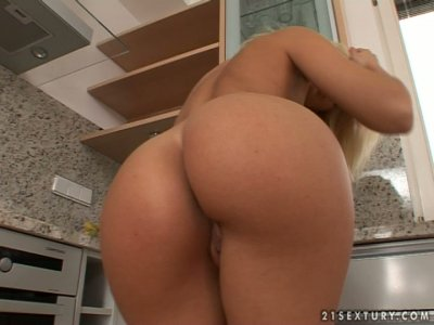 Just awesome blondie Sophie Moone masturbates in the kitchen