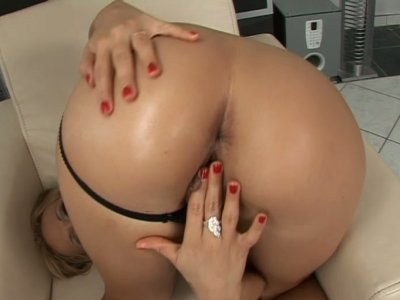 Blonde babe Candy gets her fingers wet in her delicious pussy