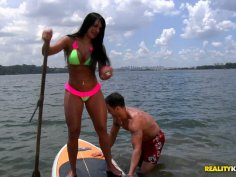 Tropical cutie Leticia is learning how to surf in the ocean