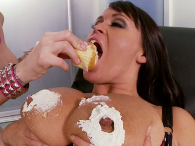 Kinky blonde whore Brandy Talore rubs big jugs of her friend with a cream and licks it off