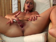Raunchy blonde slut Kathia Nobili plays with her cherry rubbing it with a dildo
