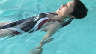 Athletic Japanese girl Mikie Hara swims in a pool like a real pro