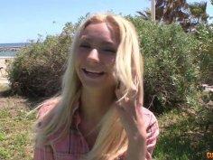 Pretty blonde babe chills outdoor