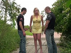 Outdoor threesome with a busty MILF