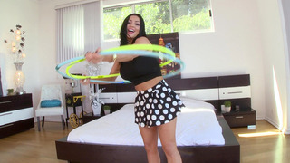 Buxom brunette Audrey Bitoni plays with the hoop Thumbnail