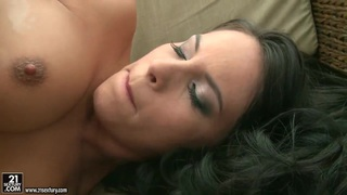 Brunette Amabella lotions her asshole and slowly shoves a black dildo in it Thumbnail