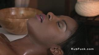 Oiled ebony gets interracial massage Thumbnail