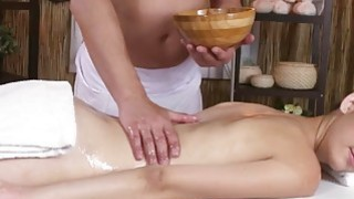 Sexy brunette enjoying a hard cock on the massage table Thumbnail