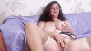 Busty mature with curly hair fingers pussy on webcam Thumbnail