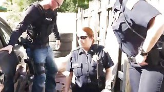 Outdoor interracial threesome with two busty female cops and big cocked stud Thumbnail