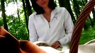 A very hot brunette teen seduces an older man in a forest and sucks his dick