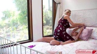 Busty stepmom disciplines her stepdaughter