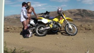 Dirtbiking gets dirty when she sucks it hard down on her knees and fucks from behind Thumbnail